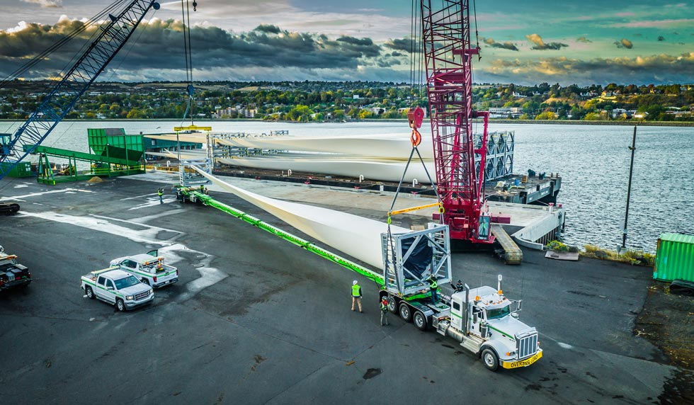 A wind turbine blade being loaded for transport at the Port of Lewiston in Idaho