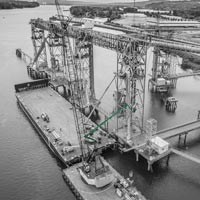 black and white and green thumbnail of Omega Morgan's millwright crew working at Kalama export grain spout