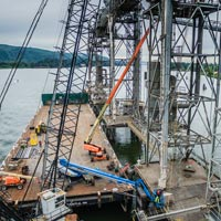 full color thumbnail of omega morgan millwright crews working on a grain spout at Kalama Export