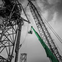 black and white and green thumbnail of 150 foot manlift and crane near grain spout for repairs