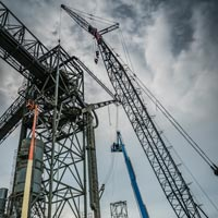 thumbnail of two 150 foot manlifts and crane near grain spout for repairs