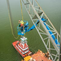 full color thumbnail of barge crane and two men working in a blue mainlift