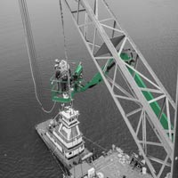 black and white and green thumbnail of barge crane and two men working in a blue mainlift