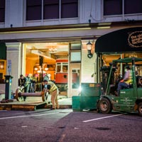 full color thumbnail of outside the Old Spaghetti Factory, Omega Morgan crews wrapping up equipment in the evening