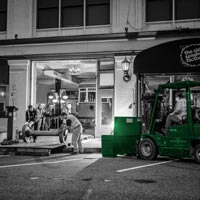 black and white and green thumbnail of outside the Old Spaghetti Factory, Omega Morgan crews wrapping up equipment in the evening
