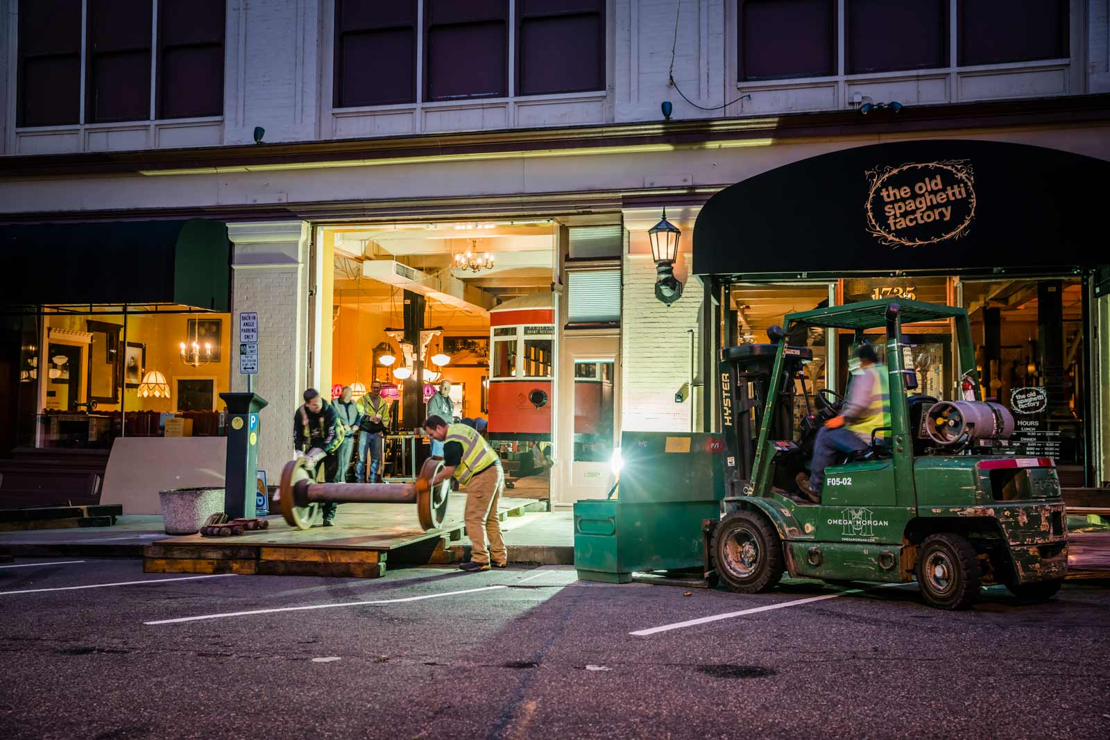 outside the Old Spaghetti Factory, Omega Morgan crews wrap up equipment in the evening