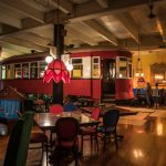 antique trolley car parked inside Old Spaghetti Factory