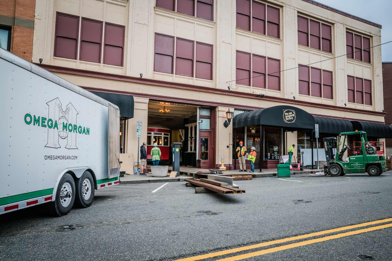 omega morgan trailer and outside of Old Spaghetti Factory while antique trolley is being put into the building