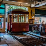 antique trolley being transported into the Old Spaghetti Factory on slide rails