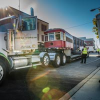 full color thumbnail of Omega morgan truck parked with antique trolley on truck bed