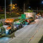 truck hauling tunnel boring machine through Seattle street