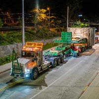 selected thumbnail of specialized transportation truck hauling tunnel boring machine through Seattle street