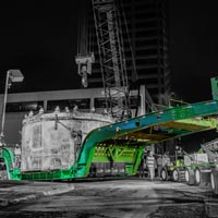 deselected button thumbnail of tunnel boring machine on Omega Morgan transport with crane preparing to lift it