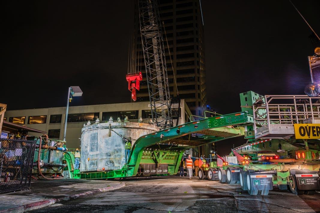 tunnel boring machine on Omega Morgan transport with crane preparing to lift it