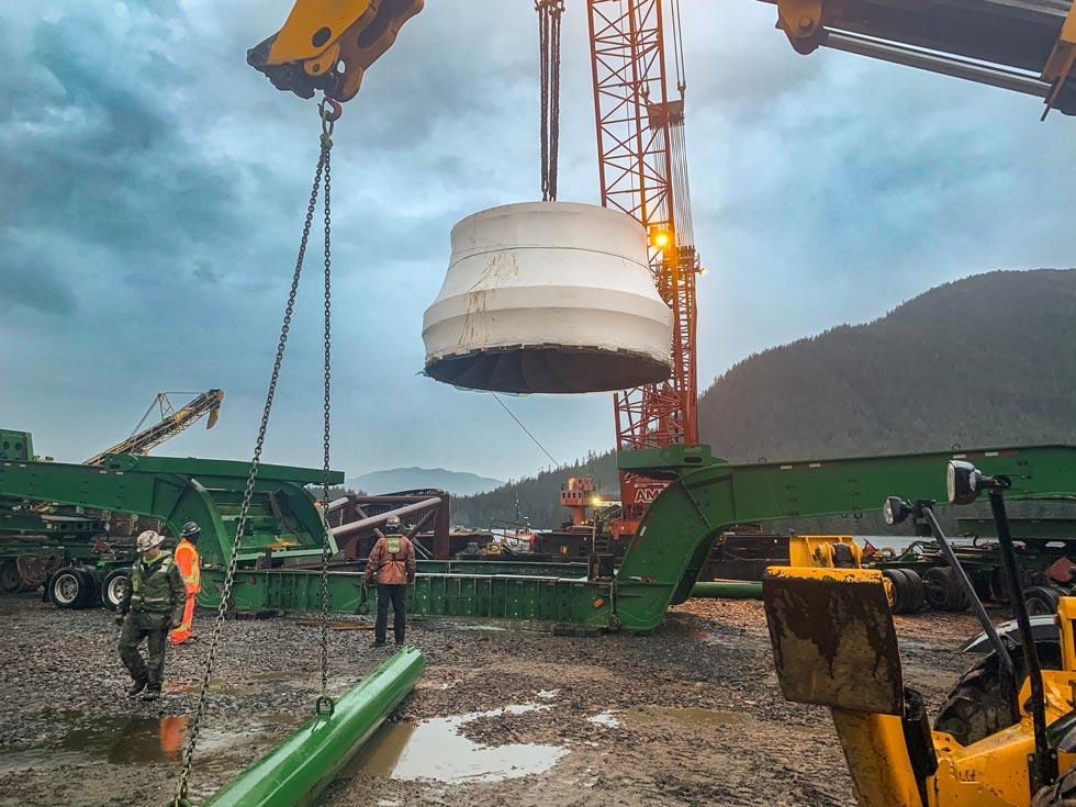 Crane lifts turbine runner on to Omega Morgan transport trailer