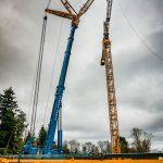 Liebherr LTM-1400 crane setting up an ECHO 550 Morrow tower crane with 260 feet of jib