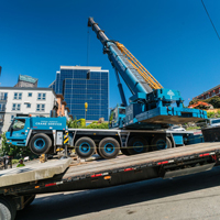 full color thumbnail of GMK 5220 crane working on a street with an 18% grade in Seattle