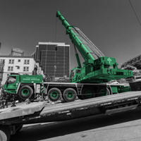 black and white and green thumbnail of GMK 5220 crane working on a street with an 18% grade in Seattle