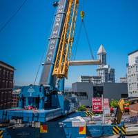 full color thumbnail of GMK 5220 crane lifting one of six vault sections in Seattle