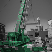 black and white and green thumbnail of GMK 5220 crane lifting one of six vault sections in Seattle