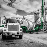 black and white and green thumbnail of truck with trailer holding vessel at chemical plant in Longview, washington