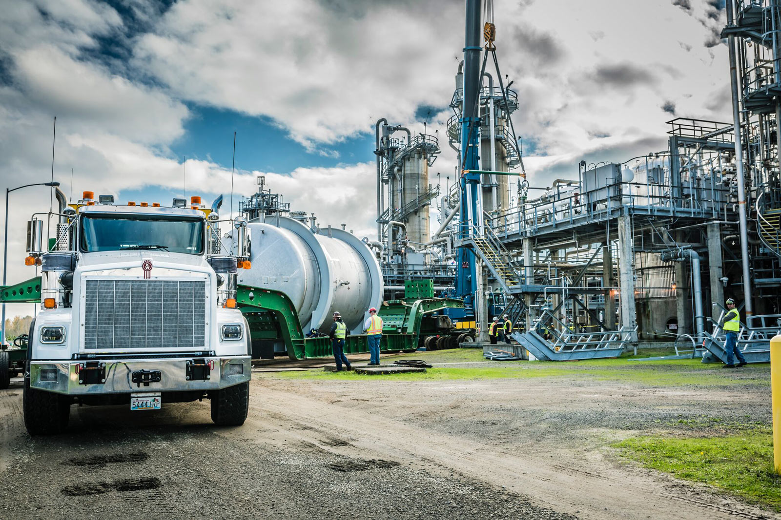 truck with trailer holding vessel at chemical plant in Longview, washington