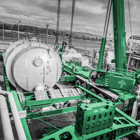 black and white and green thumbnail of omega morgan crane ready to lift cylindrical vessel from trailer
