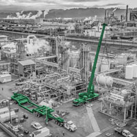 black and white and green thumbnail of blue Omega Morgan crane lifting vessel into place at chemical plant in Longview, WA