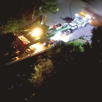 selected thumbnail button of view from the sky of Omega Morgan transporting a 158,000 pound transformer over a bridge at night