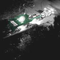 deselected thumbnail button of view from the sky of Omega Morgan transporting a 158,000 pound transformer over a bridge at night