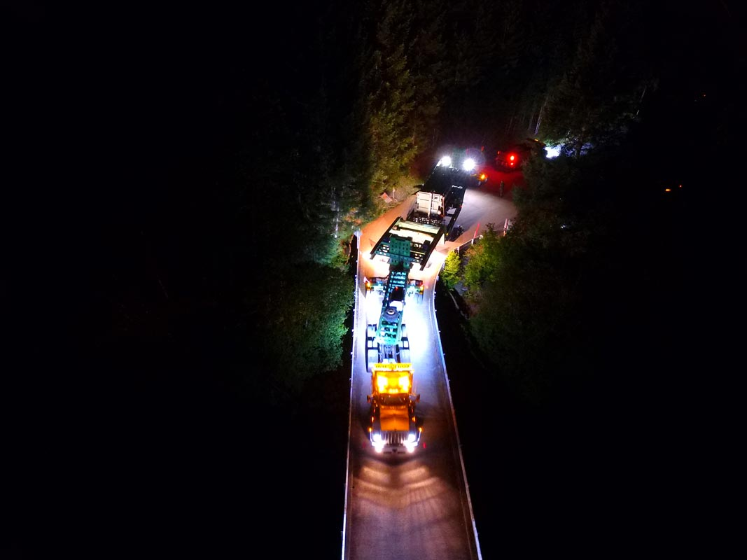 Omega Morgan transporting a 158,000 pound transformer over a bridge at night