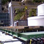 158,000 pound transformer being moved into place with weight distributed for 500 P S F
