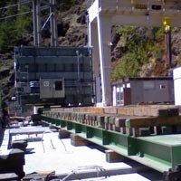 selected thumbnail button of 158,000 pound transformer being moved into place with weight distributed for 500 P S F