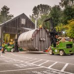 New equipment being moved by the Omega Morgan machinery moving crew at the Woodinville Whiskey distillery in Woodinville, Washington