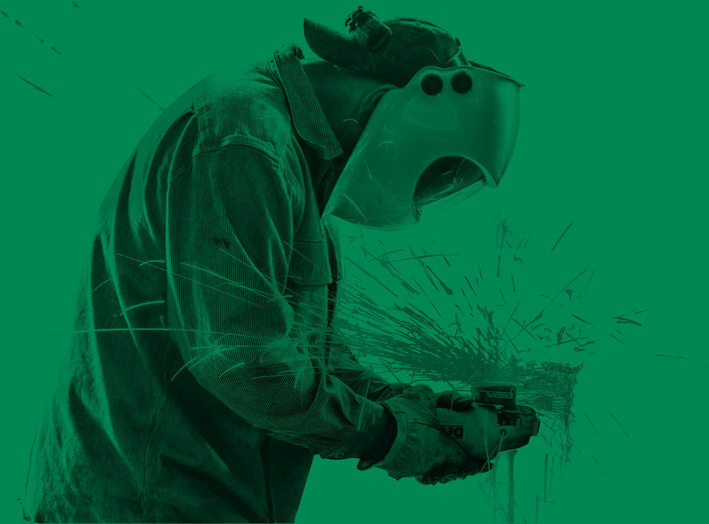 millwright wearing welding mask on a green background