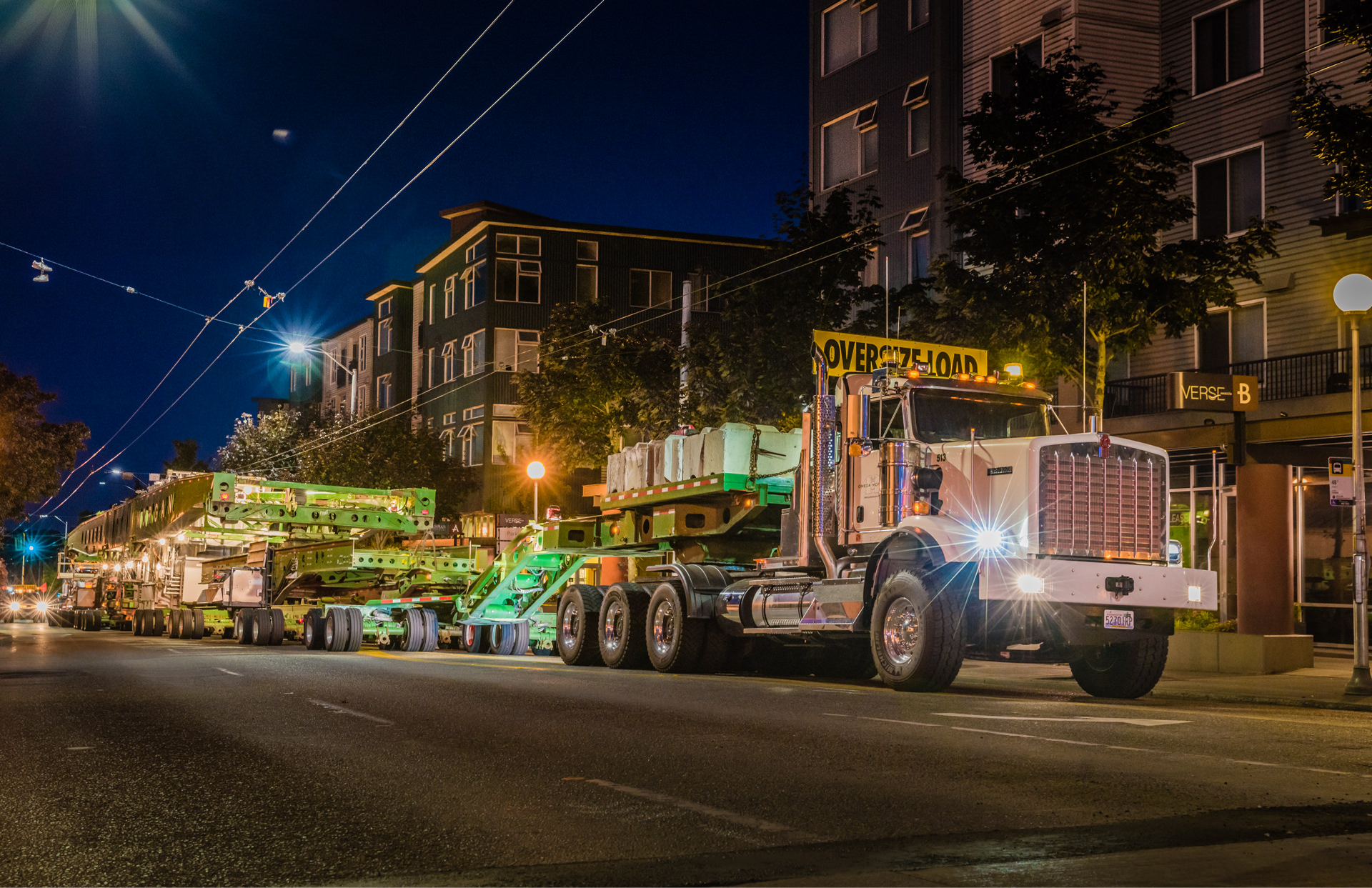 omega morgan truck with oversize load at night