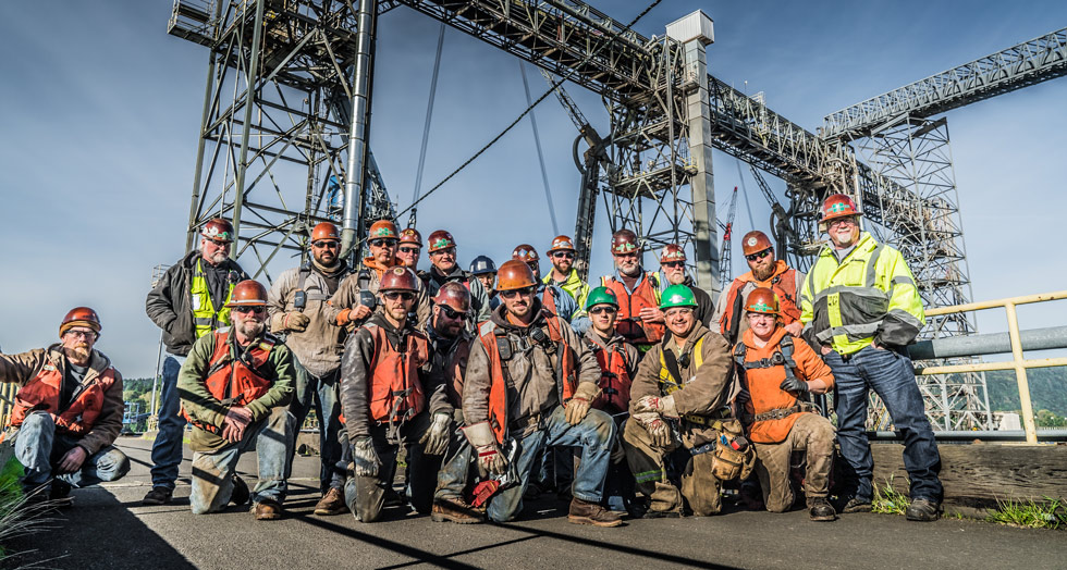 Omega Morgan millwright crew poses on the dock where they worked on a grain spout