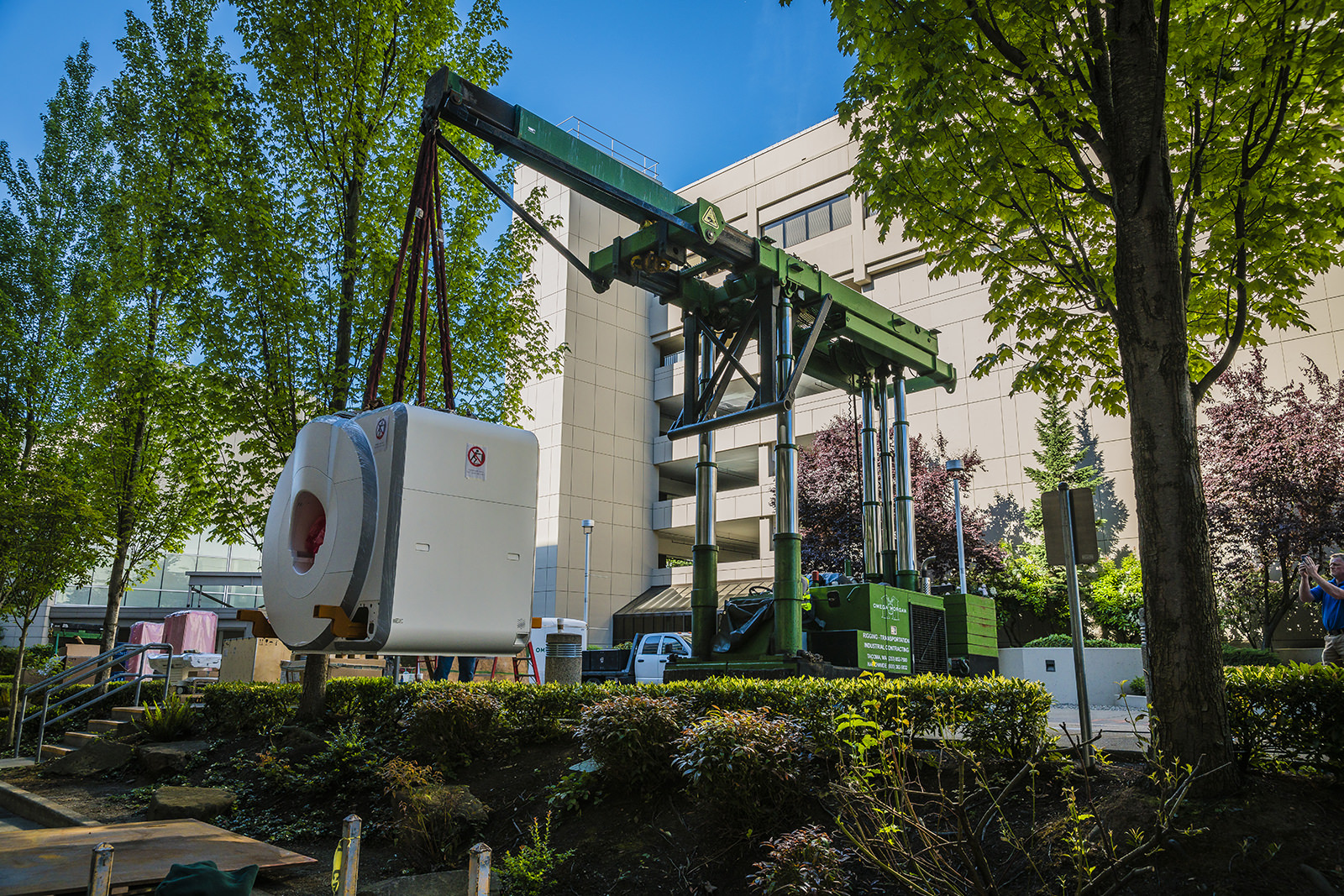 Tri-lifter with boom attachment installing MRI at Seattle hospital