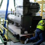 Removing chiller components from 12th floor mechanical room in downtown Portland