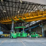 Placing overhead crane on top of tri-lifter with versa lifts