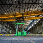 Putting overhead crane on rails with tri-lifter