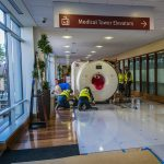 Omega Morgan team moving MRI through hospital keeping floors protected