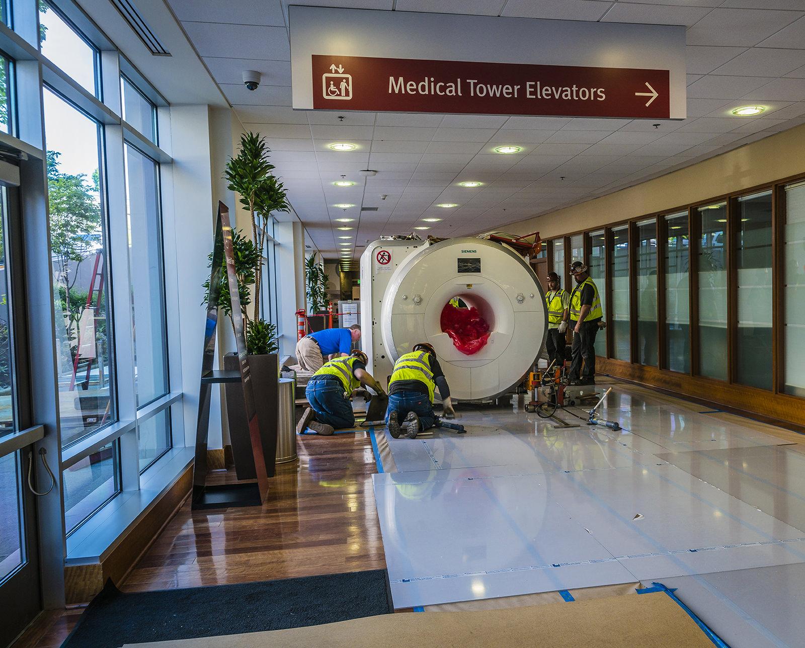 Omega Morgan team moving MRI through hospital keeping floors protected