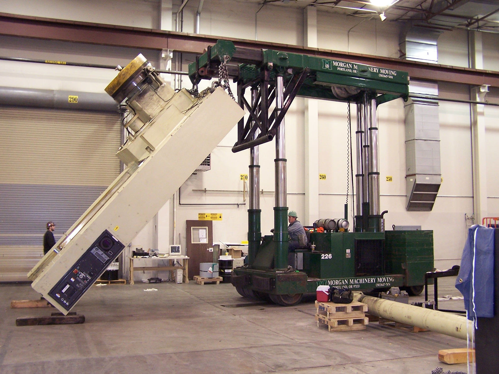 Laying over side of stamping press with tri-lifter