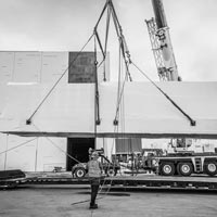 deselected thumbnail button of Omega Morgan Crane lifting a power skid off of a trailer in front of the JE Dunn data center in Hillsboro, Oregon