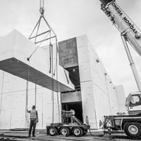 deselected thumbnail button of Omega Morgan Machinery Moving and crane crews lifting power skids into the JE Dunn Data Center in Oregon