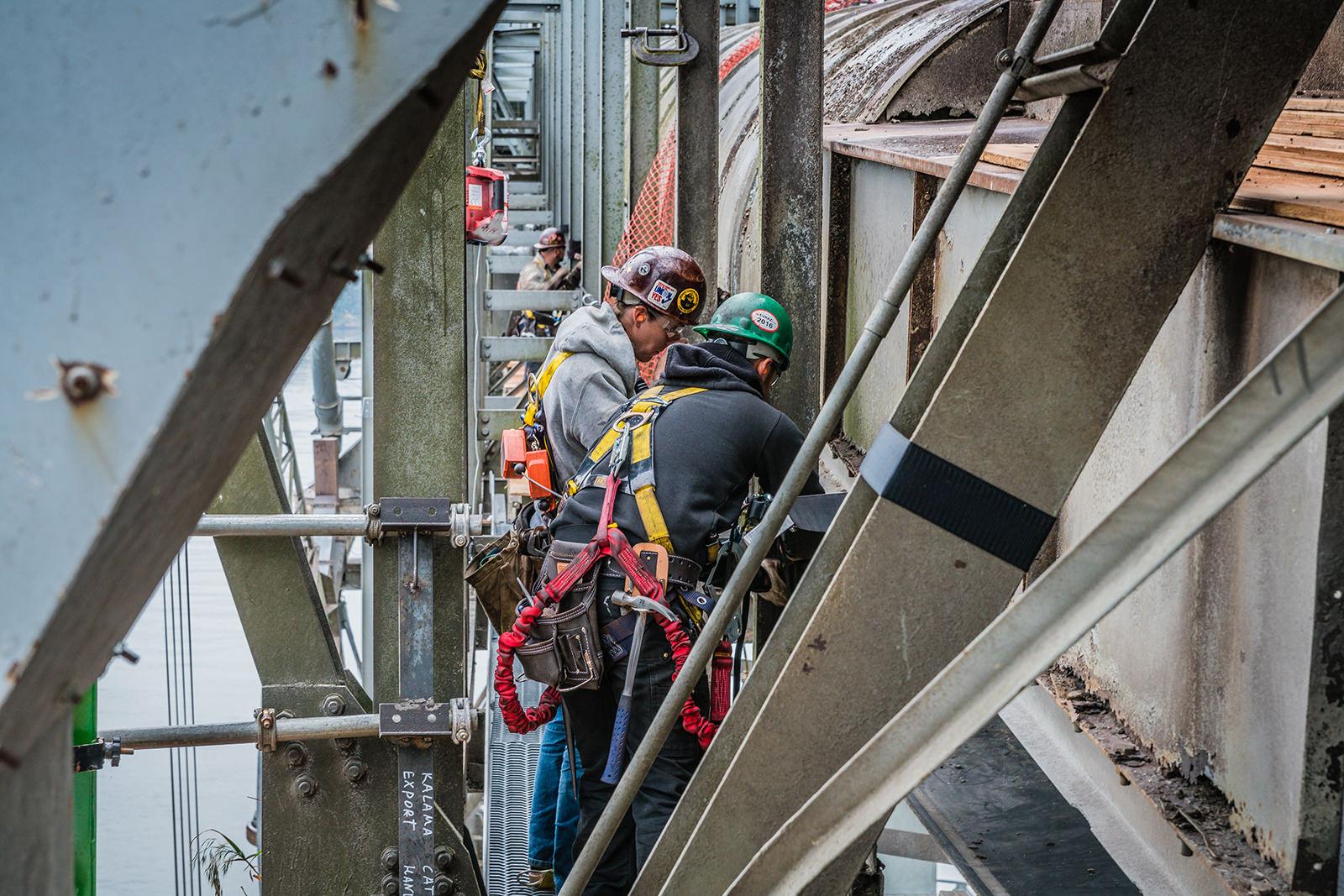 two omega morgan crew members performing onsite steel repair