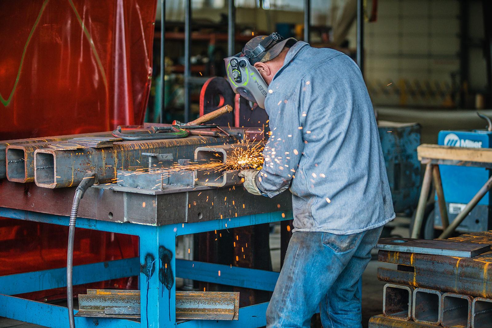 omega morgan millwright working on custom fabrication