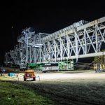 Omega Morgan Specialized Transportation crews preparing a large ship loader for transport in Vancouver, Washington at night