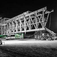 deselected thumbnail button of Omega Morgan Specialized Transportation crews preparing a large ship loader for transport in Vancouver, Washington at night